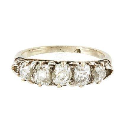 A five stone diamond set ring claw set with five graduated old round and oval cut diamonds,