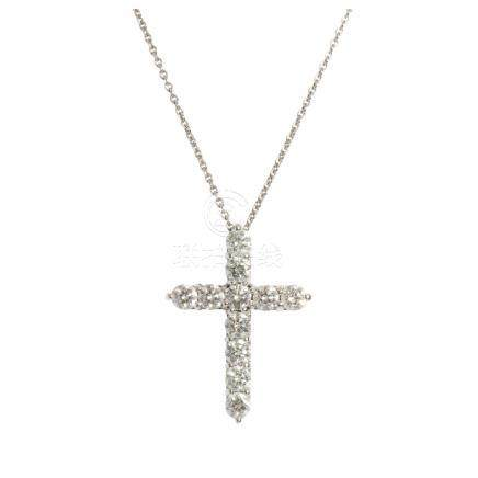 A diamond set cross pendant claw set with eleven round brilliant cut diamonds, to a plain platinum