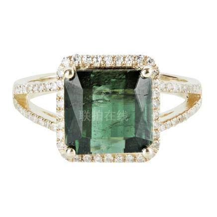 A green tourmaline and diamond set ring claw set with a mixed-square cut green tourmaline, in a