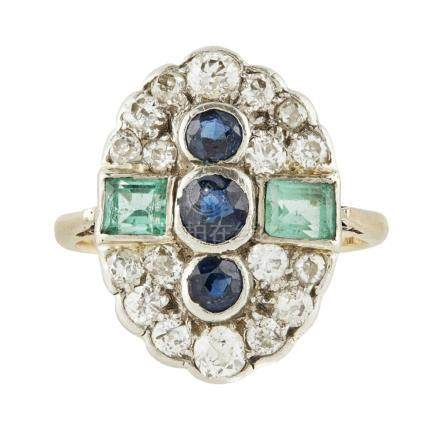 A multi-gem set plaque ring of oval form, collet set with three round cut sapphires, flanked to