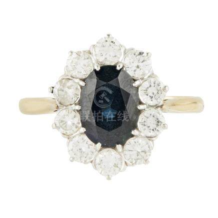 A sapphire and diamond set cluster ring claw set with an oval cut sapphire, in a border of ten round
