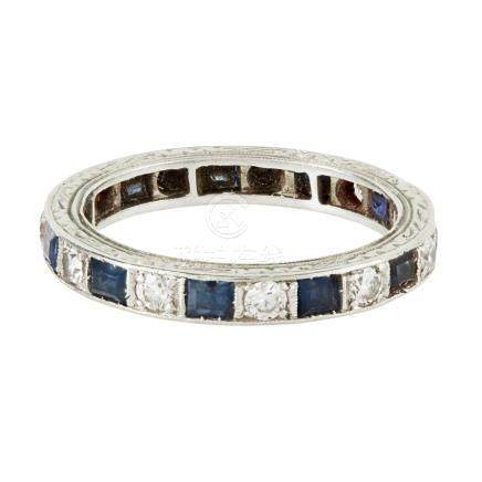 A sapphire and diamond set eternity ring channel set with a continuous row of alternating square cut