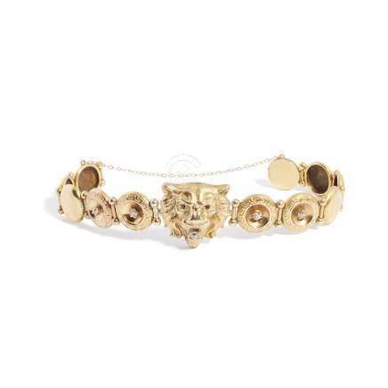 A diamond set bracelet modelled as a lion's head, with cabochon garnet eyes and an old round cut