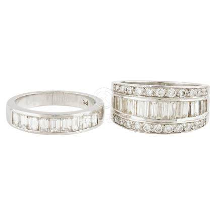 A diamond set half eternity ring channel set with a row of baguette cut diamonds, between two rows