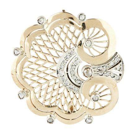 A mid-century diamond set brooch modelled as a stylised shell with pierced detail, rose cut