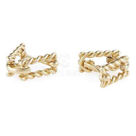 A pair of French rope twist cufflinks of triangular hinged design with rope-twist detail, French