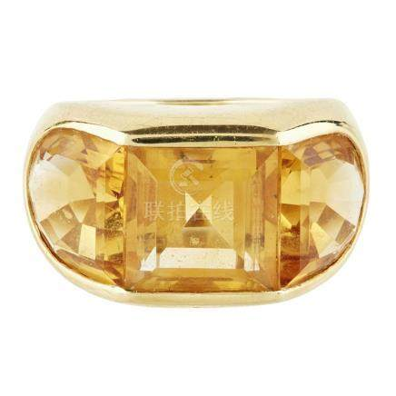 A citrine set cocktail ring channel set with a square step-cut citrine and two hemispherical fancy