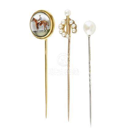 A collection of stick-pins to include one set with an Essex crystal cabochon depicting a race