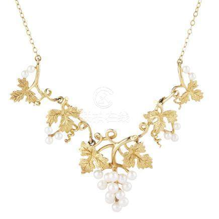 A 9ct gold pearl necklace modelled as a vine, the scrolling foliage with textured detail, suspending