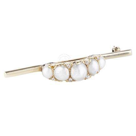 A pearl and diamond set brooch the central domed section claw set with five graduated pearls,