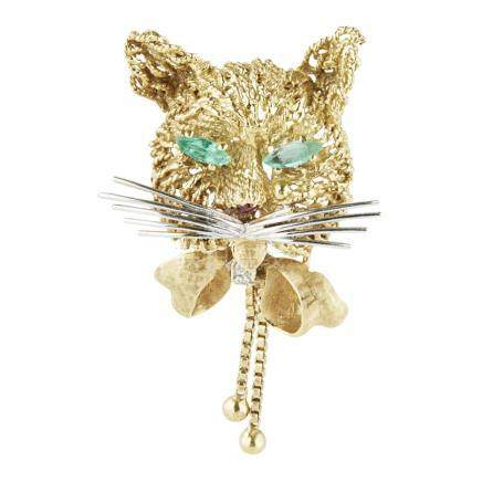 A multi-gem set novelty brooch modelled as a cat, the textured ground set with two marquise cut