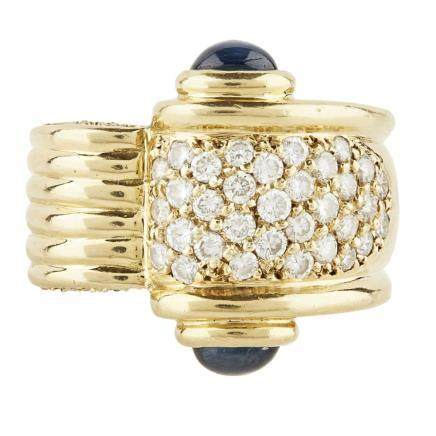 A sapphire and diamond set cocktail ring of broad curving design with ribbed detail, pavé set