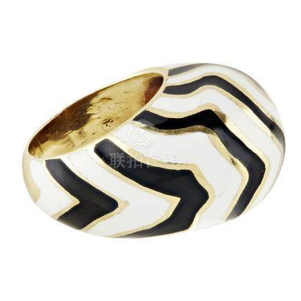 An enamel set cocktail ring of domed design, with black and white striped enamel detail, stamped 18k