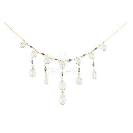 An aquamarine and sapphire set necklace the trace link chain collet set at intervals with oval cut