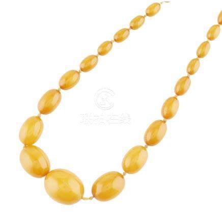 An amber bead necklace composed of graduated amber beads, to a concealed screw clasp Overall length: