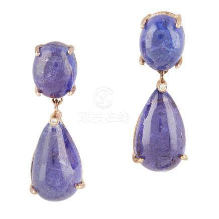 A pair of Tanzanite and diamond pendant earrings each claw set with an oval Tanzanite cabochon,