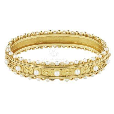 A Victorian pearl set bangle of hinged design, the front half with beaded and wirework detail