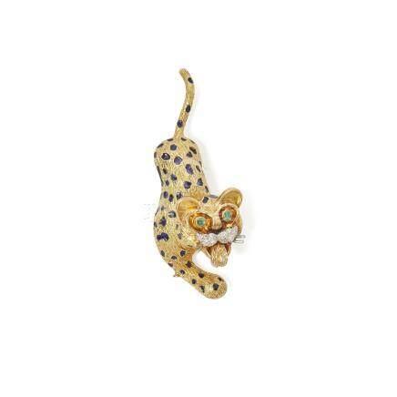An 18ct gold multi-gem set leopard brooch, Kutchinsky modelled in a stalking stance, the spots set