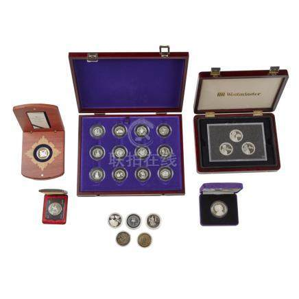 A collection of various proof coins to include: Perth Mint, wood cased commemorative gold and silver