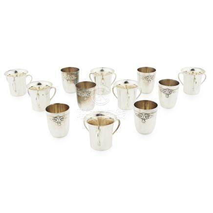 A set of six French silver tot beakers of plain shape with embossed threaded border and floral