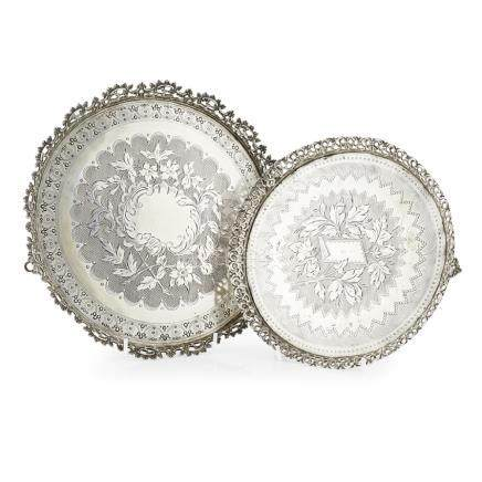 Two circular Portuguese salvers Porto, circa 1890-1900, each on three openwork feet chased on