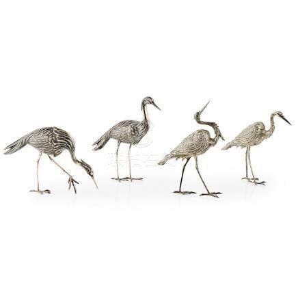 A group of four storks marked Star possibly Spanish, each in a different pose and realistically