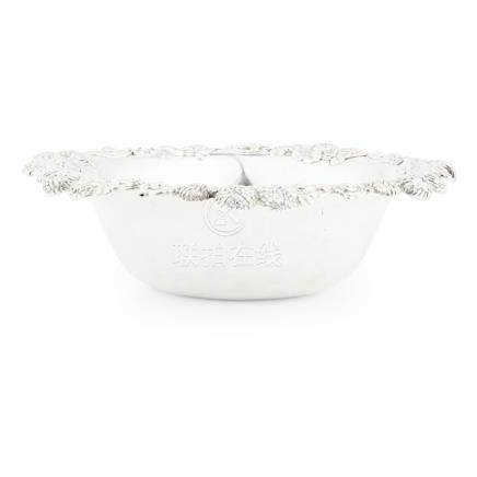 A bowl, Tiffany & Co the everted rim with a pierced cast border of chrysanthemums, marked to