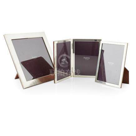 A collection of silver mounted frames, Asprey all hallmarked for Sheffield 2005, with wooden