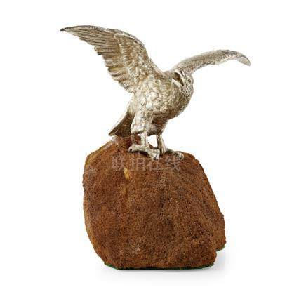 A modern eagle figurine B S E Products, London 1978, modelled as an eagle preparing for flight