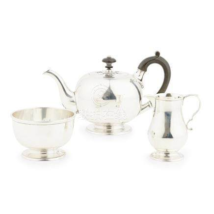A three piece tea service Goldsmiths & Silversmiths Company, London 1921, comprising teapot, sugar