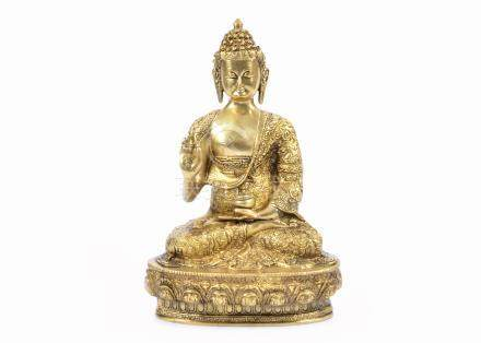 A gilt bronze statue of a Buddha, seated in dhyanasana and wearing monk's robes, 32 cm high