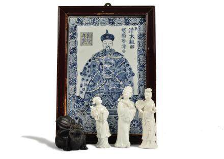 A porcelain panel depicting a Chinese emperor, edged with floral details, framed, 35 cm x 25 cm,