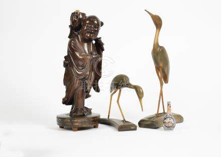 A collection of Asian works of art, including a Chinese hardwood figural lamp base, 37 cm high;