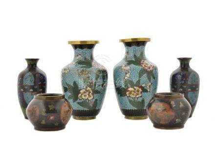 Three pairs of cloisonne vases, comprising an ovoid pair with floral decoration on blue ground, 16