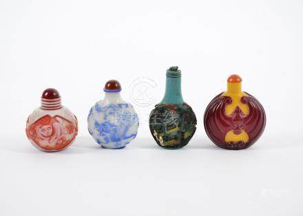 Three 20th Century Chinese Peking glass scent bottles, comprising a flattened ovoid example with red