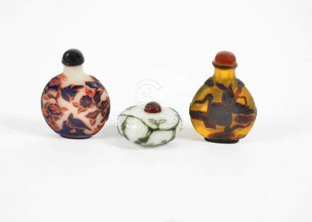 Three 20th Century Peking glass scent bottles, comprising a blue and red over frosted flattened