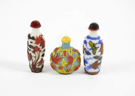 Three 20th Century Chinese Peking glass scent bottles, comprising a red and yellow over blue