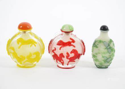 Three 20th Century Chinese Peking glass snuff and scent bottles, comprising two flattened ovoid