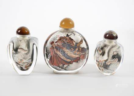 Three 20th Century Chinese reverse painted glass snuff and scent bottles, comprising two with dragon