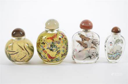 Four 20th Century Chinese reverse painted snuff and scent bottles, comprising a geese and peacock