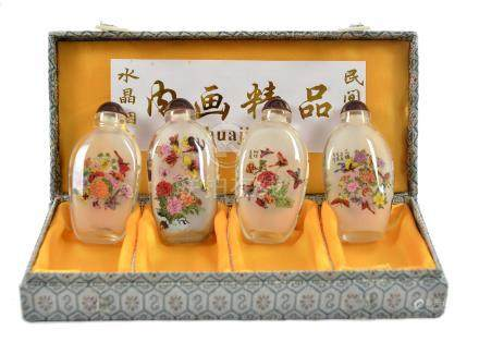 A cased set of four 20th Century Chinese reverse painted scent bottles, each decorated with