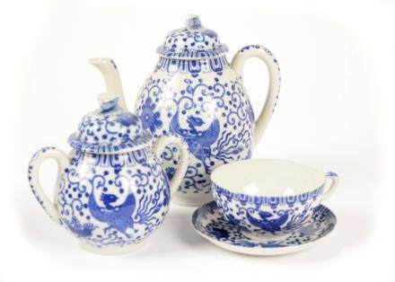 A 20th Century Japanese porcelain part tea service, blue and white phoenix and scroll decoration,