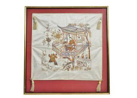 A Chinese silk embroidered panel, depicting three figures in a house and garden, the panel with
