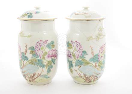 A pair of Chinese porcelain jars and covers, each with enamel floral decoration, character marks