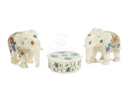A pair of modern Indian carved alabaster elephants, each with inlaid floral decorations, 16 cm long;