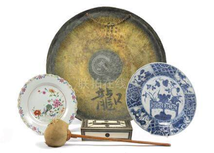 A 20th Century Japanese gong with striker, 50 cm diameter; together with a Chinese famille rose