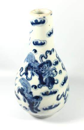 A CHINESE BLUE AND WHITE KANGXI STYLE BOTTLE FORM VASE WITH DRAGONS CHASING THE FLAMING PEARL