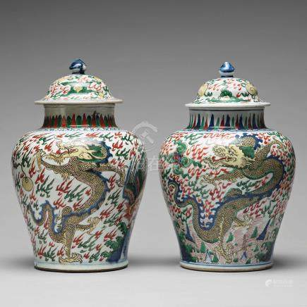 Two Transitional Wucai Baluster vases and covers, 17th Century.