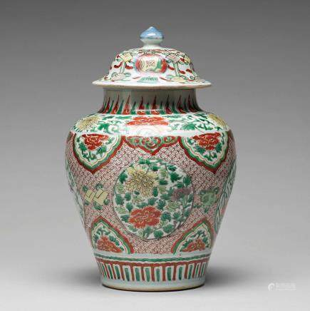 A Transitional wucai baluster vase with cover, 17th Century.