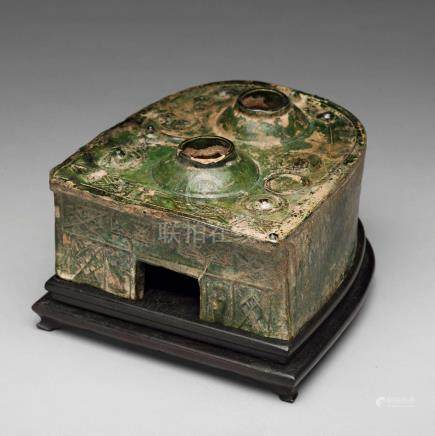 A green glazed pottery model of a stove, Han dynasty (206 BC-220 AD).